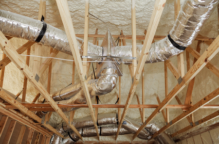 installation of heating system on the roof of the pipe house heating system with tubes, pipes, valves close up 스톡 콘텐츠