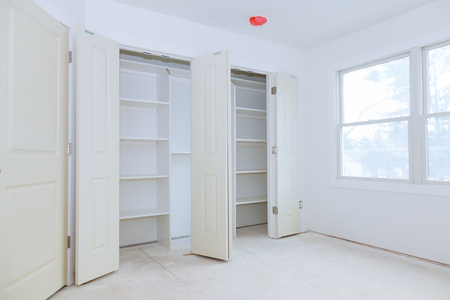 Assembling The Closet With Wooden Shelves Installation Of Shelves Stock  Photo   95396677
