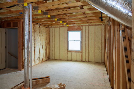 Attick loft insulation partly isolated wall Heat isolation in a new house Stock Photo