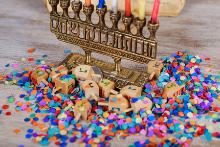 Jewish holiday, Holiday symbol Hanukkah Image of jewish holiday Hanukkah with wooden dreidel spinning top on the glitter background Archivio Fotografico