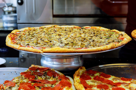 Pizzeria restaurant Manhattan New York.of Pizza is consumed in the Untied States alone in one day. Pizza in the pizzeria on the counter