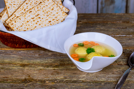 Traditional Jewish passover dish matzah ball soup served with matzah, Jewish symbols for the Passover Pesach holiday Stok Fotoğraf - 97328945