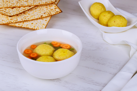 A traditional Ashkenazi Jewish soup with matzo balls, made from a mixture of matzah meal, chicken bouillon matzah, Jewish symbols for the Passover Pesach holiday
