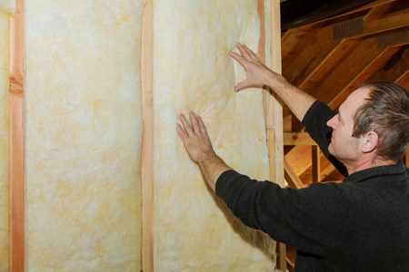 Installation of thermal and hidro insulation Inside wall insulation in wooden house, building under construction