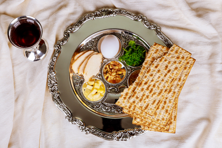 Pesah celebration concept jewish Passover holiday . Traditional pesah plate text in hebrew: Passover, egg,