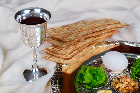 Jewish symbols for the Passover holiday concept with wine and matzoh over rustic background with copy space Stockfoto