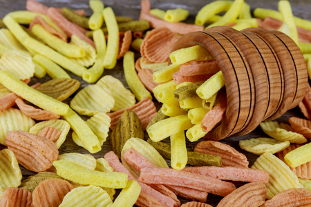 Large bowl of chips on a wooden table Cheese chips background
