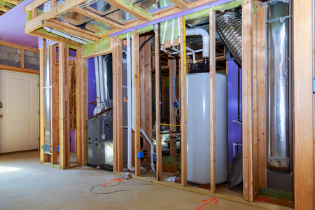 Interior wall framing with piping and wiring installed installation of pipes for water for new buildings