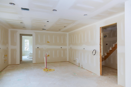 Drywall is hung in kitchen remodeling project Interior of apartment with materials during on the renovation Archivio Fotografico
