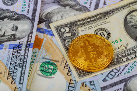 golden bitcoin coin on us dollars close up dollar banknotes with golden cruptocurrency bitcoin Zdjęcie Seryjne