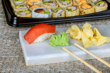 Nigiri sushi with salmon, grouper, eel, tuna and prawn, served Delicious traditional Japanese food, tasty seafood, restaurant concept, food background Stock Photo