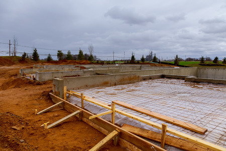 New homes in the process of being built with foundations in the foreground