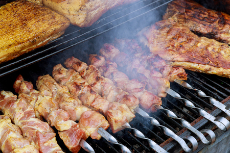 Shish kebab preparation with meat on the barbecue grill