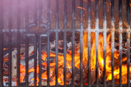 Barbecue Fire Grill close-up, BBQ Grill With Vibrant Flames Black Background