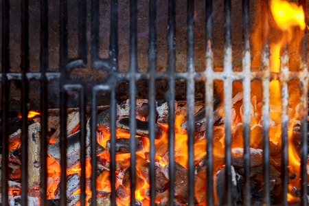 Hot Empty Clean BBQ Grill With Vibrant Charcoal Flames On The Black Background. Cookout Concept. Stock Photo