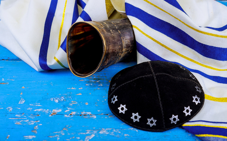shofar horn on prayer talit, rosh hashanah jewish traditional holiday symbol.