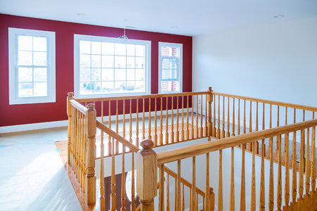 New construction home boasting beautiful staircase with wood railings and hardwood floors.