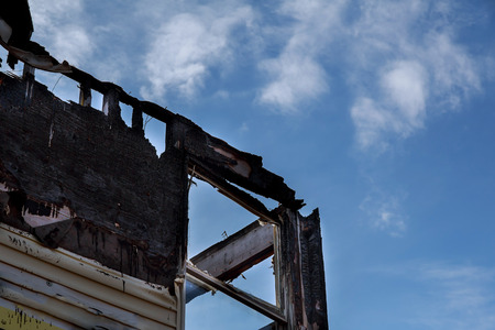 Burned-down house burnt black room after fire