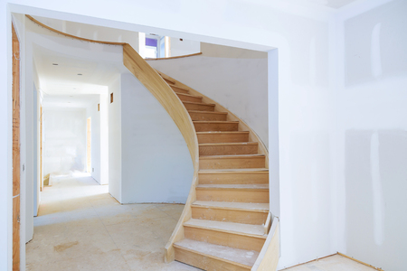 Walls of unfinished renovated living room of inside house under construction Imagens