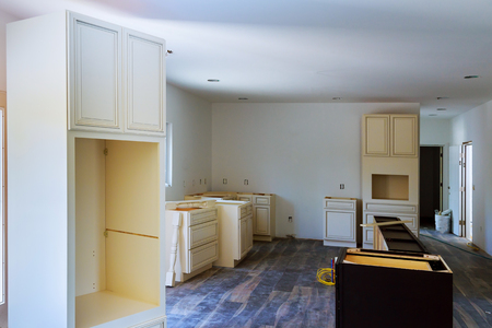 Installed wood kitchen cabinets with modern of installs cabinet. Banco de Imagens