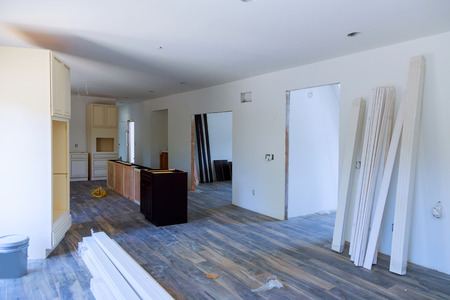 Custom installation of kitchen cabinets in various stages of base for island in center