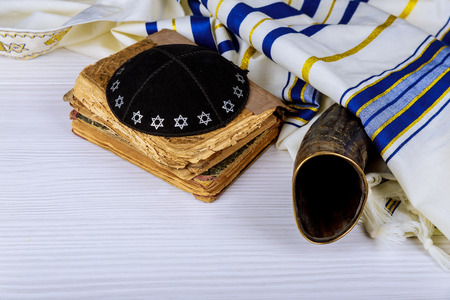 Hebrew handwritten Torah, on a synagogue alter, with Kippah and Talith shofar rams horn