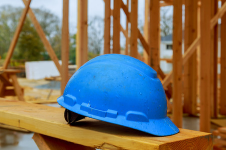 Construction work safety helmets for professional builders are placed on wooden boards. Safety helmets for industrial workers
