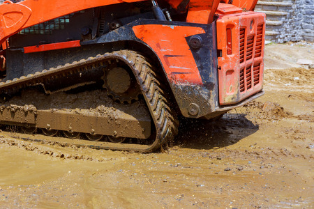 Construction tractor working with pile of digging earth works in construction site quarry Stock fotó