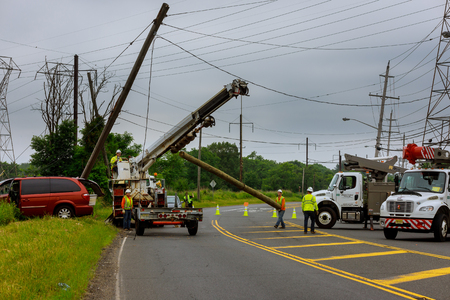 Sayreville NJ USA - Jujy 02, 2018: installation of replacing the electric pillar after a car accident supports during of highway in a summer day.