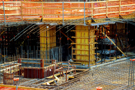 close up view of reinforcement of concrete with metal rods connected by wire. Preparation for pouring
