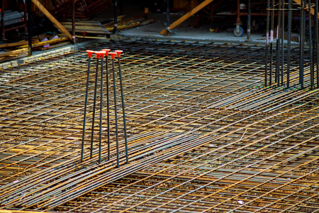 view of reinforcement of concrete with metal rods connected by wire. Preparation for pouring crutches preparing for building house Stock Photo