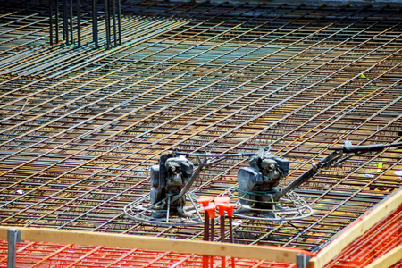 Closeup of Steel rebars. Geometric alignment of Rebars on construction site Reinforced steel rods for building structures., Steel Rebars for reinforced concrete.