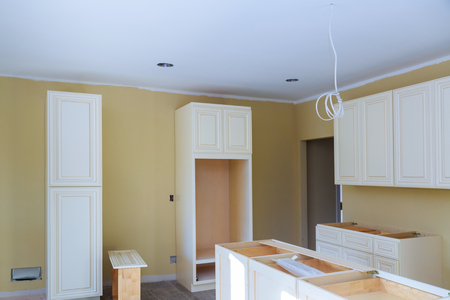 Kitchen cabinets installation Blind corner cabinet, island drawers and counter installed