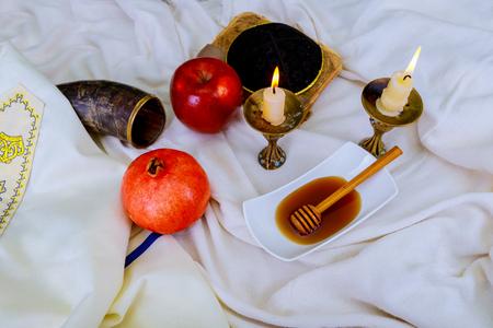 Honey, apple and pomegranate for traditional holiday symbols shofar rosh hashanah jewesh holiday