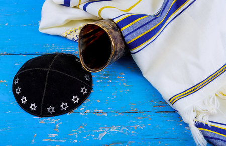 shofar horn kippah and tallit on white prayer talit. rosh hashanah jewish holiday traditional holiday symbol. talis
