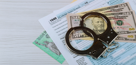 Stimulus economic tax return check with money and refund check