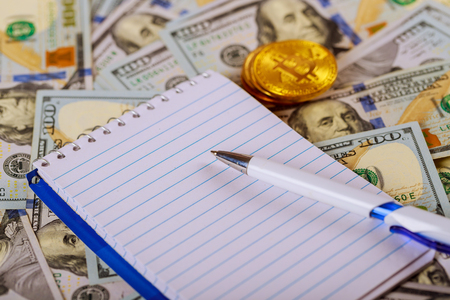 Money banknote US dollar and coins put on wooden table with silver pen, notebook and saving jar on background, Currency, financial economy, earning income, management concepts Stock Photo