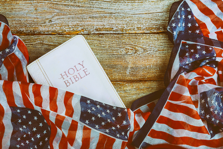 Close-up of Holy Bible, and American Flag
