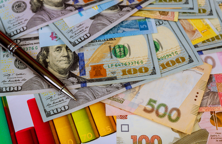 Ukraine money bills and hundred american dollars ukrainian hryvnia and the US dollar.