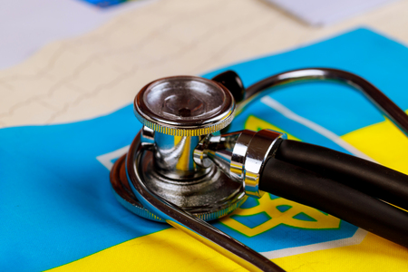 Stethoscope and cardiogram with Ukraine national flag conceptual series - Ukraine Standard-Bild