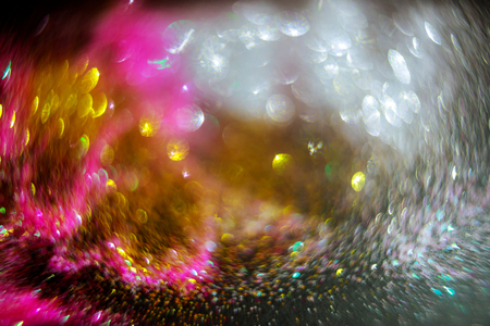Abstract colored defocused bright light as romantic background