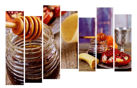 Jewish holiday shofar, torah book, honey, apple and pomegranate Rosh Hashanah traditional holiday symbols. Standard-Bild