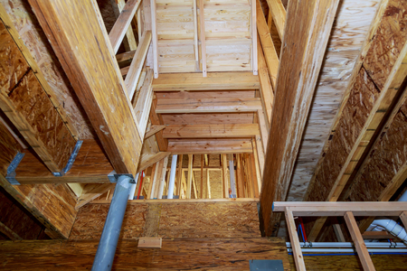 wooden beams at construction new residential construction house framing Stock Photo