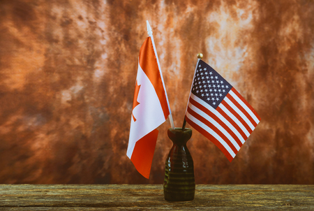 Maintenance on construction tools with copy space for Labor day American and Canadian flag