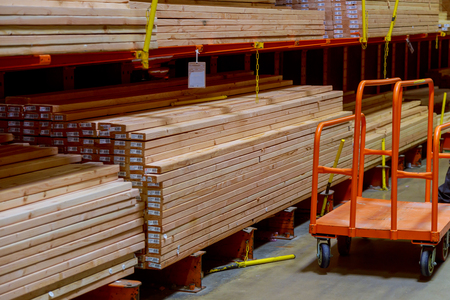 Wood stacked on shelving inside a lumber yard concept, construction of houses