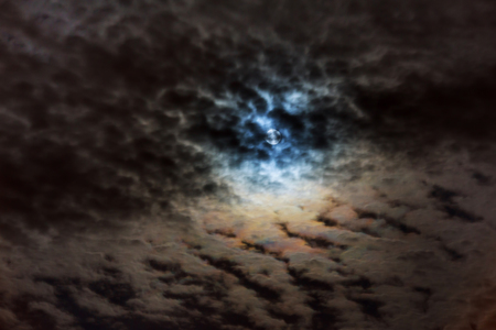 Dramatic clouds in the mysterious night sky with full moon in the moonlight