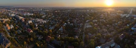 High altitude aerial view of the fantastic cityscape, view from Uzhgorod Zakarpatya Ukraine during sundown. Stock Photo