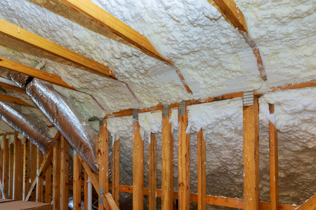 New home construction with installation of termal insulation installing at the attic the roof Stock Photo