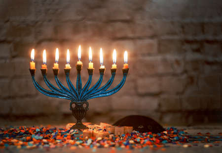 The lit of hanukkah candles in a menorah
