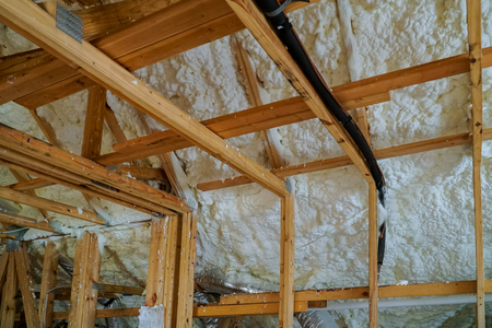 Installing thermal foam insulation under the roof foam wool panels and polyurea Spraying, foam coating